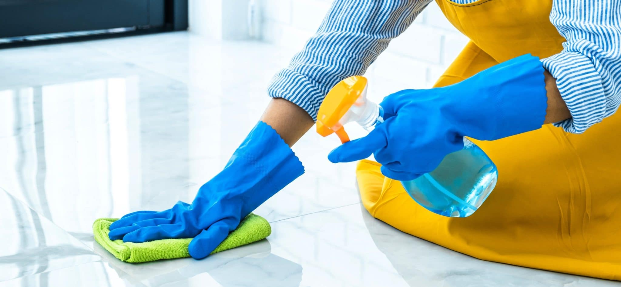 Woman cleaning a tile floor